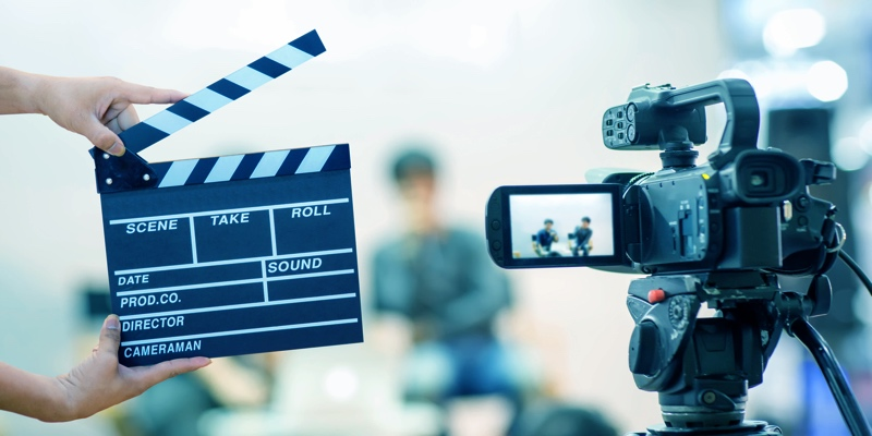 Clap board and video camera for a movie shoot