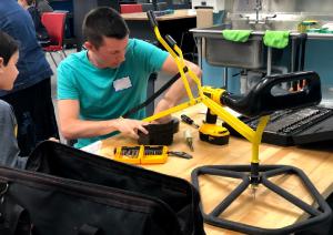Volunteer repairing a mechanical toy